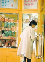 Sex shop assistant in a lab coat